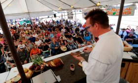 an area cook provides a demonstration on Taste of Colorado festival in Denver, CO