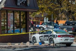 photo - The rear screen of a Colorado Springs Police automobile is shattered by weapon fire at the Wendy's restaurant on Wahsatch Avenue in Colorado Springs as authorities investigate the one for the moments from a shooting rampage that left three sufferers dead Saturday morning, Oct. 31, 2015, in Colorado Springs. The shooting started on Prospect Street near Platte Avenue and ended at Wahsatch and Platte ways where police exchanged gun fire, killing the suspected shooter. (The Gazette, Christian Murdock)