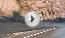Mudslide sweeps away car in Colorado - video